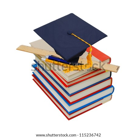 Graduation cap on top of stack of books - stock photo