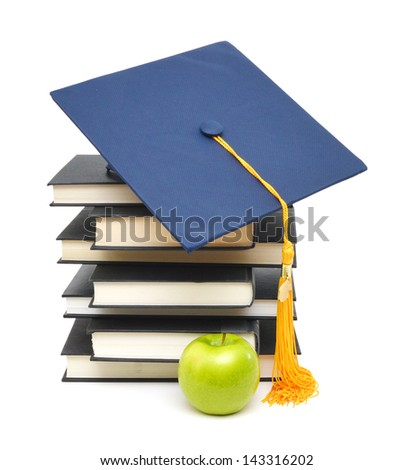 Graduation cap over leather diploma cover and books - stock photo