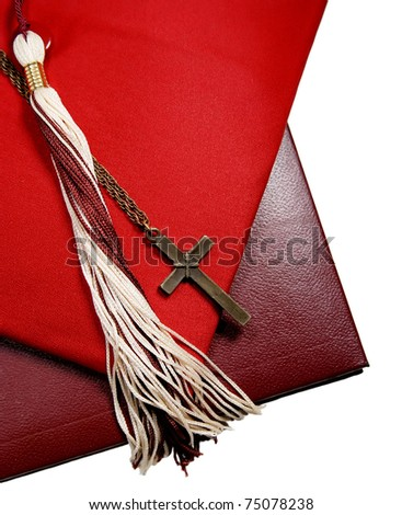 graduation cap with tassel, diploma and cross - for a religious graduation theme, isolated on white - stock photo