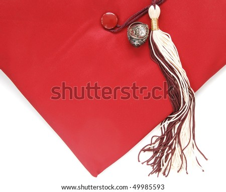 graduation cap with tassels and class rings - stock photo