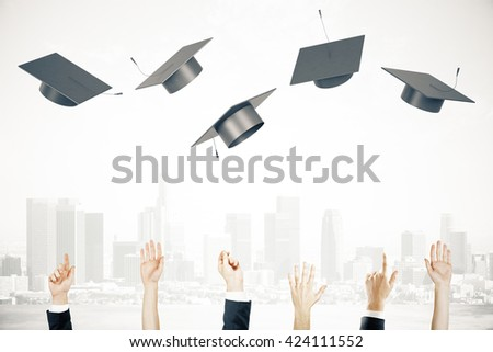 Graduation concept with businesspeople hands throwing up graduation caps on foggy city background