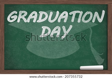 Graduation Day Message, Graduation Day written on a chalkboard with chalk and a grad cap