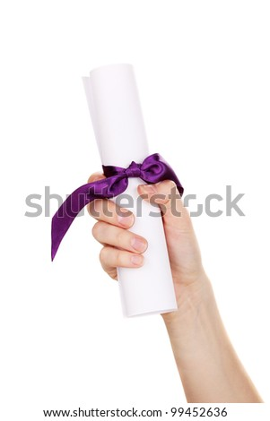 Graduation diploma in hand isolated on white - stock photo