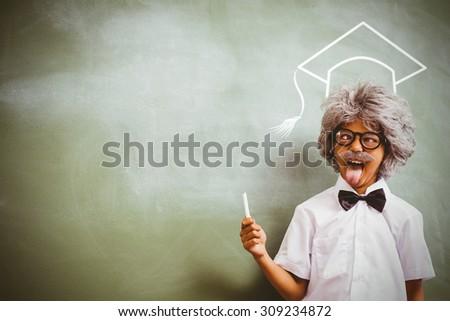 Graduation hat vector against boy dressed as senior teacher in front of blackboard - stock photo