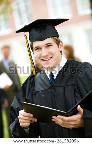 Graduation: Male Student Happy to Have Diploma - stock photo
