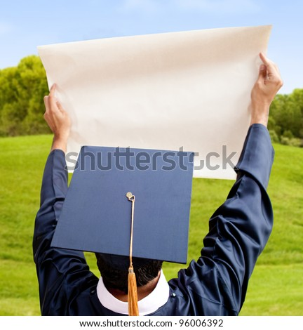 Graduation man holding paper (copy space) - isolated over a white background