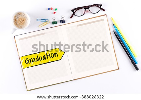 Graduation text on notebook with copy space - stock photo