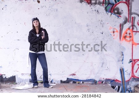 Graffiti Artist with spray can - stock photo