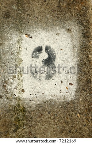 graffiti number three painted on a concrete wall - stock photo