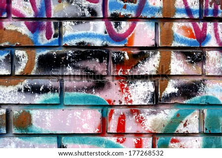 Graffiti on a wall - detail of a graffiti painted on a wall - stock photo