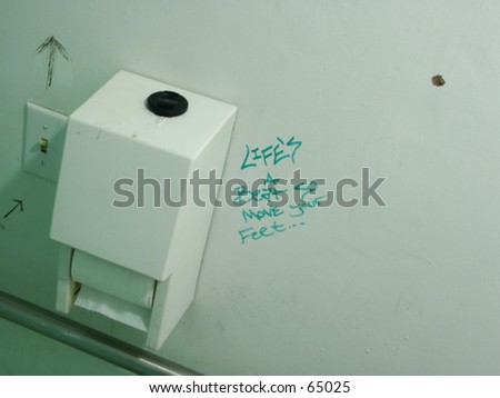 Graffiti on Bathroom Wall - stock photo