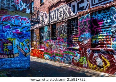 Graffiti on walls in Graffiti Alley, Baltimore, Maryland. - stock photo