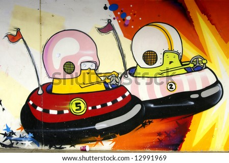 Graffiti: Space-creatures in carts - stock photo
