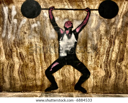 Graffiti stencil of a man weightlifting - stock photo