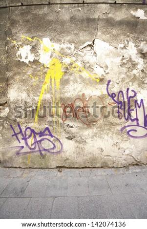 Graffiti tags on old wall - stock photo