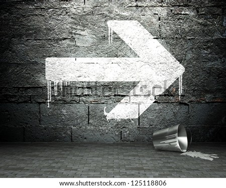 Graffiti wall with arrow sign, street art background - stock photo