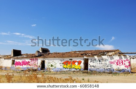 Grafitti painted in abandoned house. - stock photo