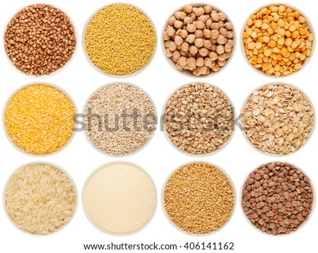 Grain and cereal food selection in porcelain bowls: buckwheat, millet, chick-pea, peas, crushed corn, crushed barley; barley, oat flakes, rice, semolina, crushed wheat; lentil. Isolated on white. - stock photo