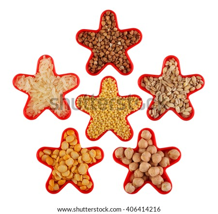 Grain and cereal food selection in shape of star: buckwheat, rice, millet, pearl barley,  peas, chick-pea. Isolated on white. - stock photo