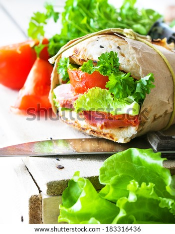 Grain bread sandwiches with ham,cheese and fresh vegetables / healthy food background/ Closeup of a fresh ham sandwich.