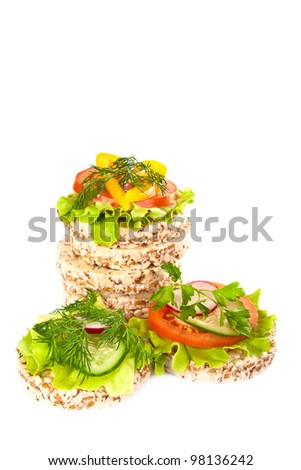 Grain breads and vegetable cutting on a white background.