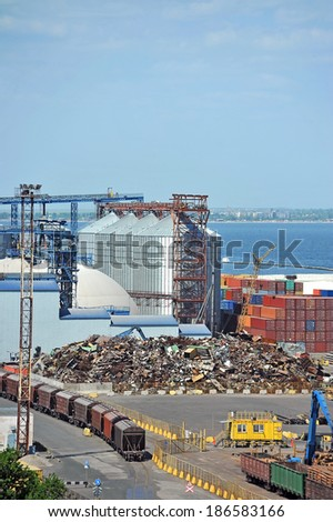 Grain dryer, train and scrap metal in the port of Odessa, Ukraine