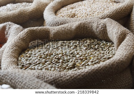 Grain food in jute sack - stock photo