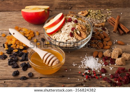 Grain free oat free paleo granola: mixed nuts, seeds, raisins, honey and coconut oil, wooden background, selective focus - stock photo