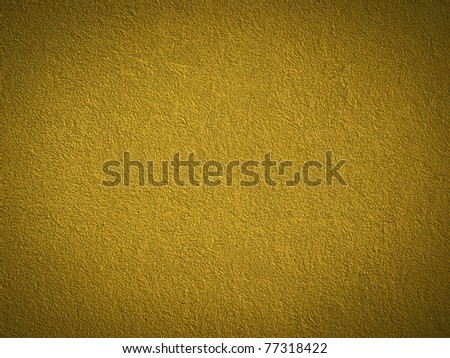 Grain gold paint wall background or texture - stock photo