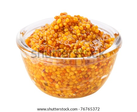 Grain mustard in transparent glass bowl, isolated on white - stock photo
