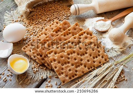 grain rye Crispbread, cereal crackers on table - stock photo