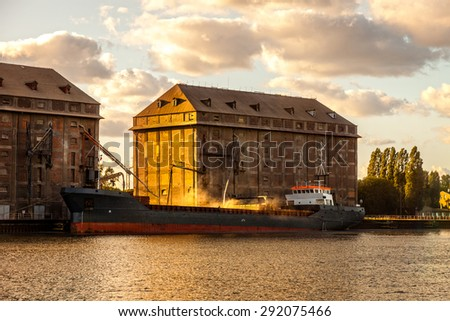 Grain Ship being loaded in Port of Gdansk, Poland. - stock photo