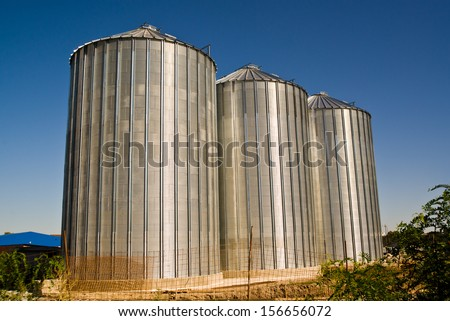 Grain silos construction site in finishing phase. - stock photo