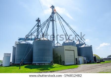 Grain silos on sunny day - stock photo
