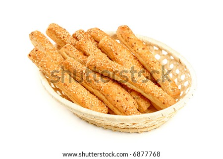 Grain sticks with sesame in basket, isolated - stock photo