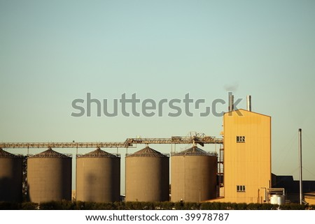 Grain storage facility at a at a food processing factory. - stock photo