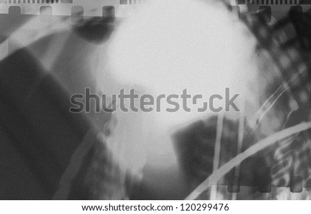 Grained black and white film strip abstract grunge texture with light effect