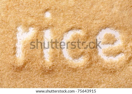grains of rice in the form of inscriptions - stock photo