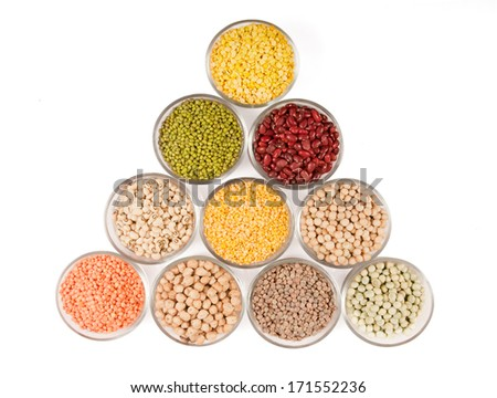 Grains pulses and beans in bowl over white over - stock photo