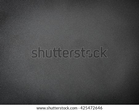 Grainy black textured background with spotlight - stock photo