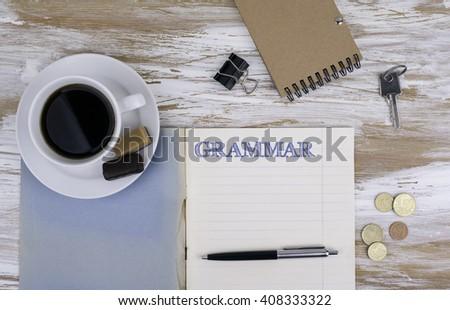 Grammar - Copybook on the desktop.  - stock photo