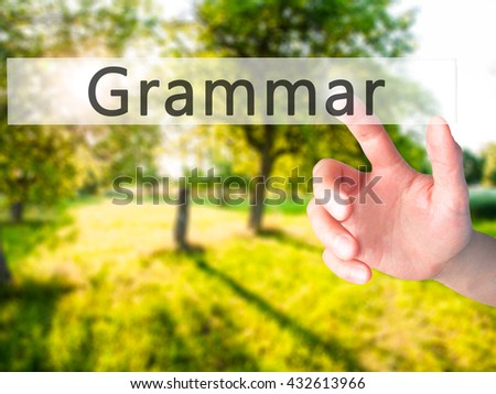 Grammar - Hand pressing a button on blurred background concept . Business, technology, internet concept. Stock Photo - stock photo