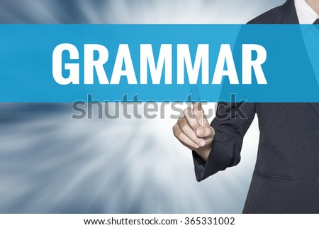 Grammar word on virtual screen touch by business woman cyan sky tab - stock photo