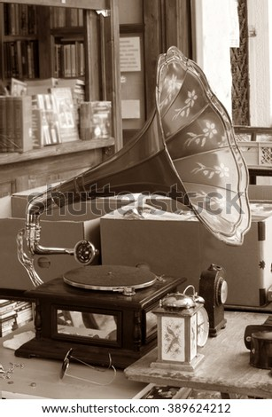 Gramophone for sale at flea market in Athens. Sepia - stock photo