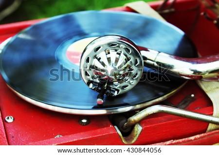 Gramophone needle on a vinyl record close. Vintage gramophone play the jazz music. - stock photo