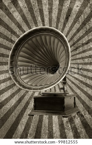 gramophone with horn speaker for playing music over a grungy background with light rays