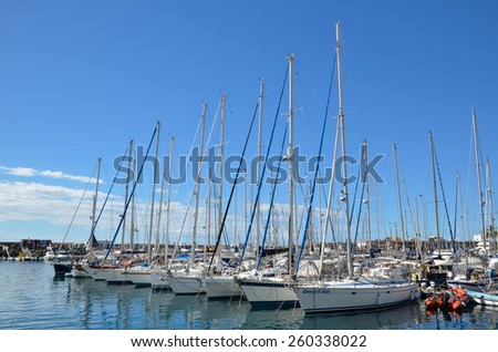 GRAN CANARIA, SPAIN - FEBRUARY 13: View at yachts in the marina in Puerto de Mogan, Gran Canaria, Spain. A popular harbor for sailors. Photo taken on February 13, 2015 in Gran Canaria, Spain. - stock photo