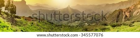 Gran Canaria sunrise panorama. Mountains at Gran Canaria (Spain) at sunset - stock photo