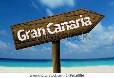 Gran Canaria wooden sign with a beach on background - stock photo