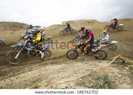 "GRANADA, SPAIN - APRIL 20 : Unknown racer on the competition "" Motocross Championship to Granada"" on April 20, 2014 in Granada, Spain - stock photo"